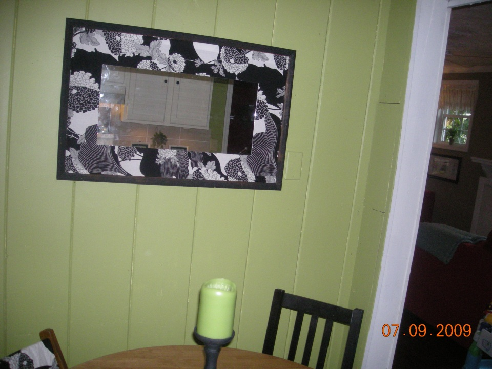 A mirror I made using spraypaint, fabric and of course, hot glue